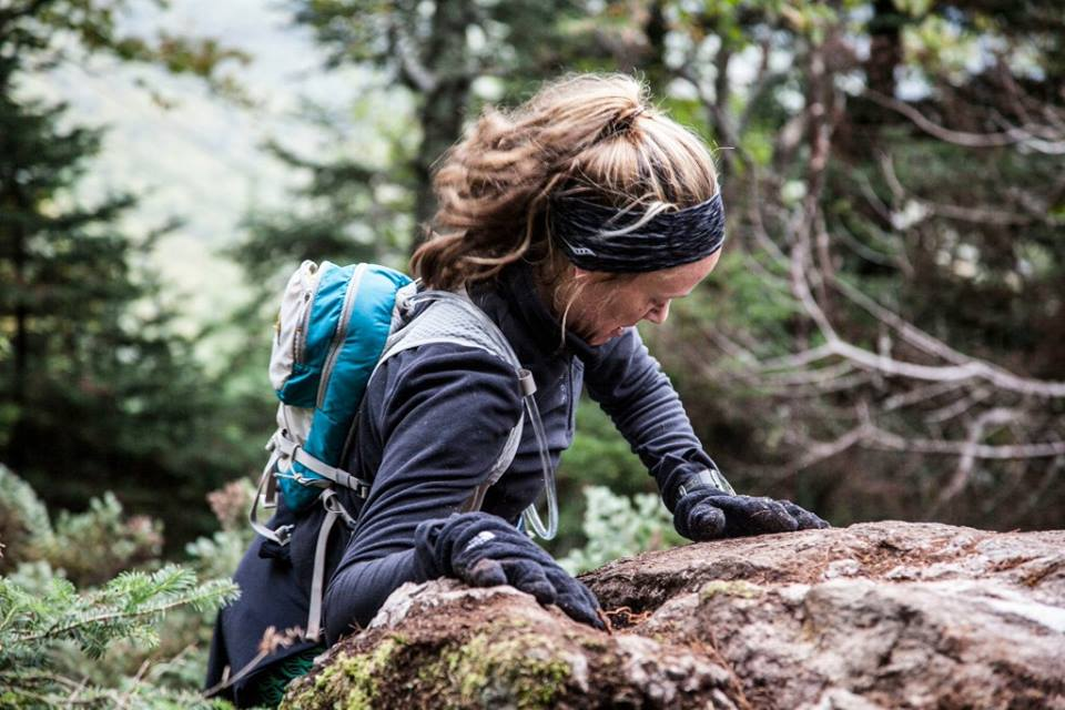 Heather Hart climbing a trail using her hands. How to Start Trail Running: Transitioning from Road to Trails