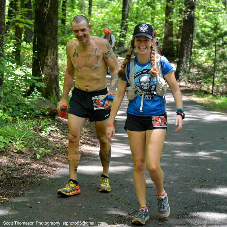 Happy runners completing a 100K Ultramarathon