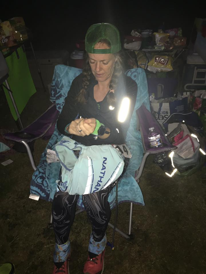 Heather Hart waking up from nap mid 100 miler.  Sitting in chair looking tired.
