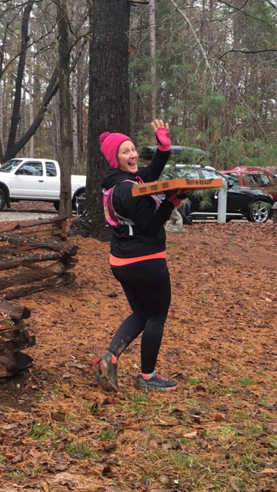 Woman carrying a pizza during a 50K