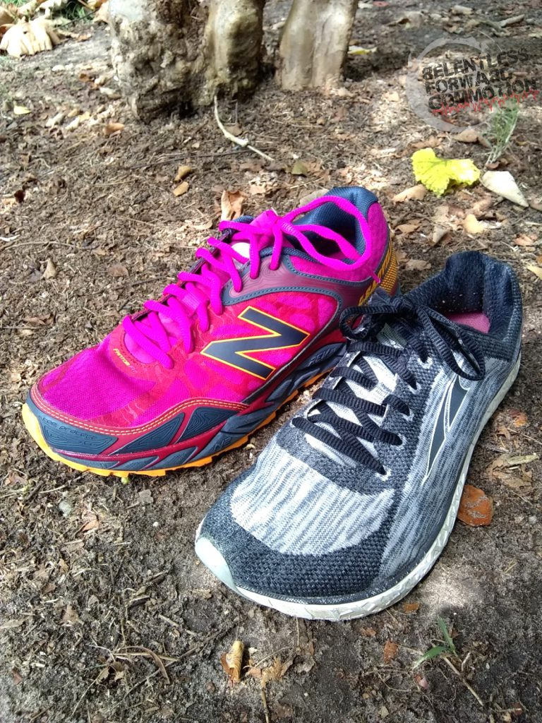 Example of a trail running shoe next to a road running shoe.