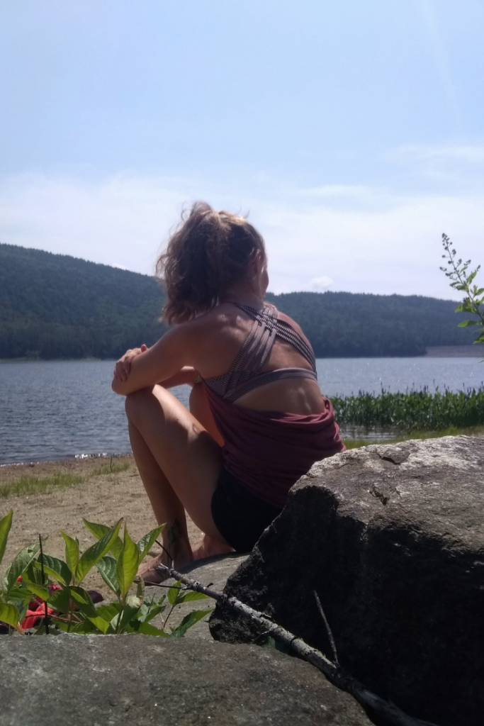 Runner resting by a lake