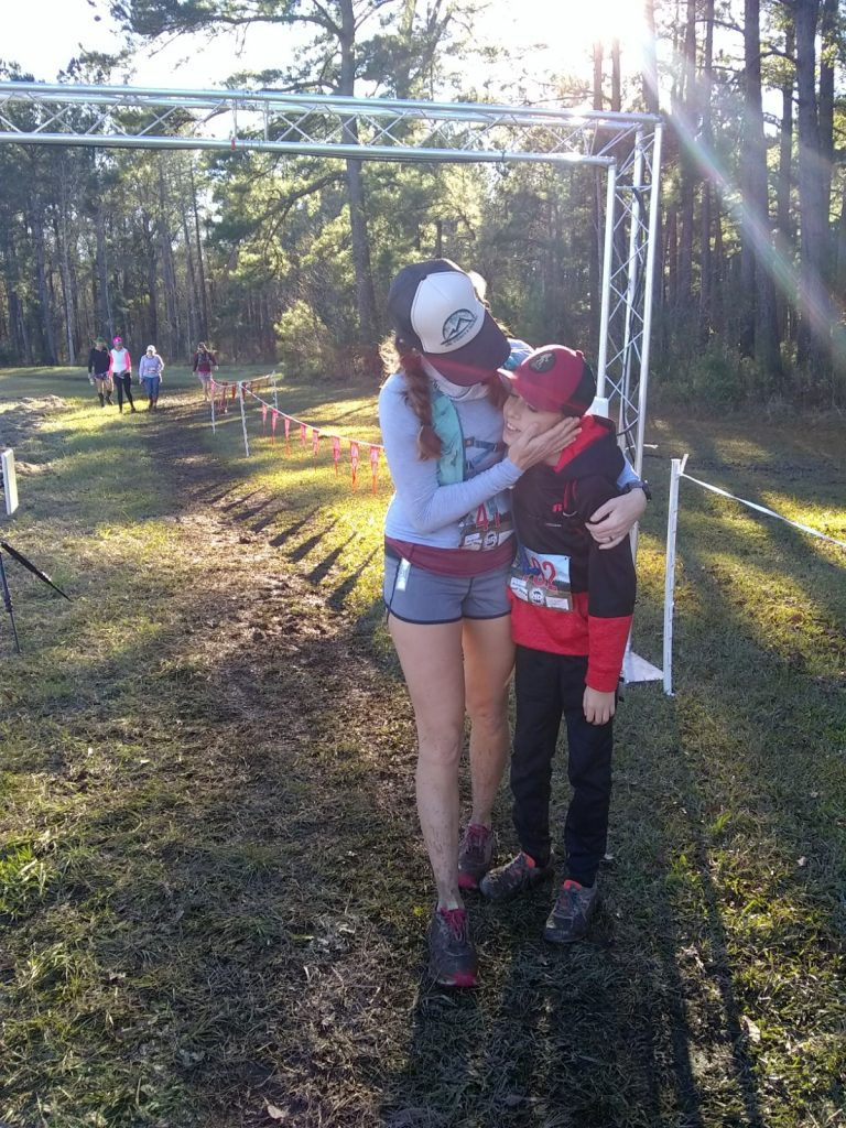 Mom congratulates son at the end of a running race