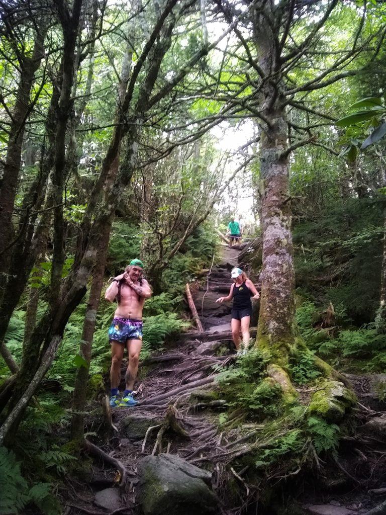 Trail runners descending a very difficult, technical climb