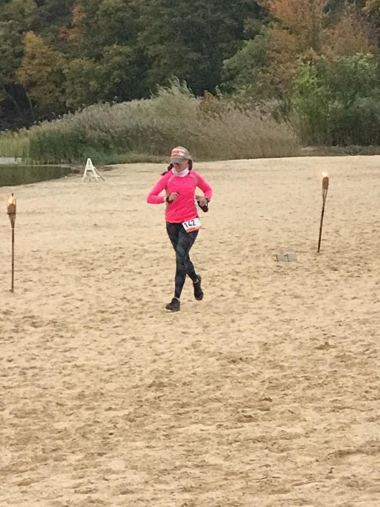 Running across the beach at Ragnar Trail Relay Wawayanda Lake