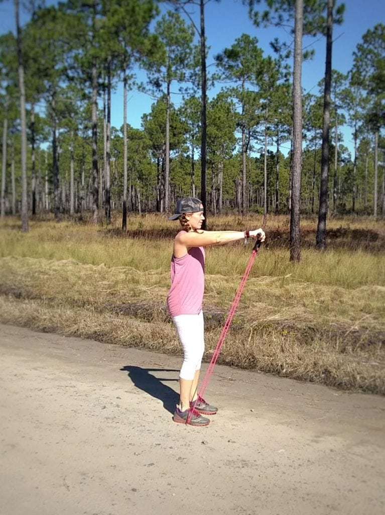 6 Quick Full Body Resistance Band Moves to Beat the Holiday Chaos: Shoulder Front Raise