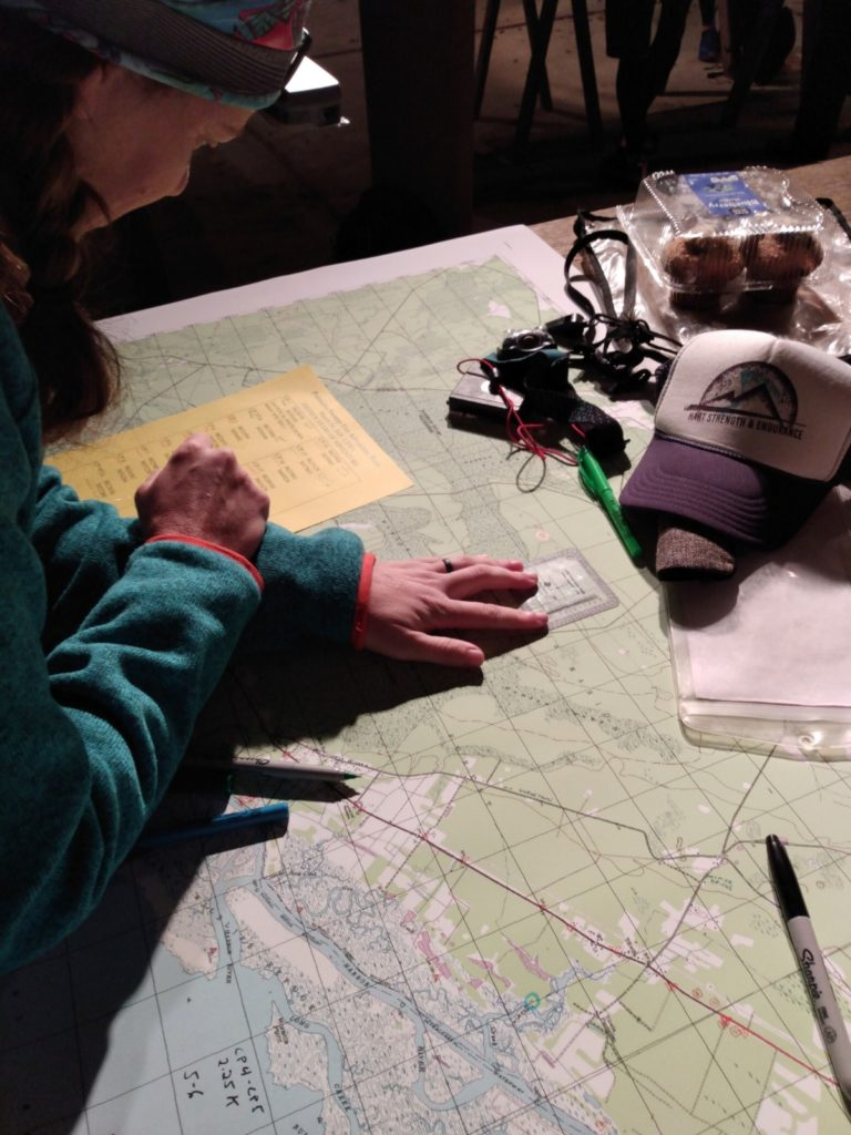 Adventure Racing participant plotting check points on a map