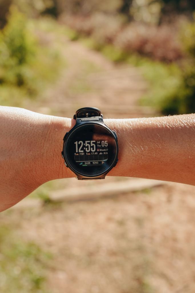 Runner wearing a heart rate monitor wrist watch