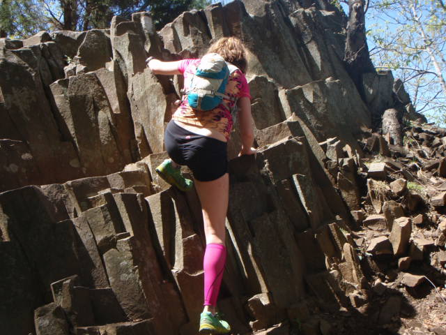 Heather Hart Climbing rocks during 7 Sisters Trail Race