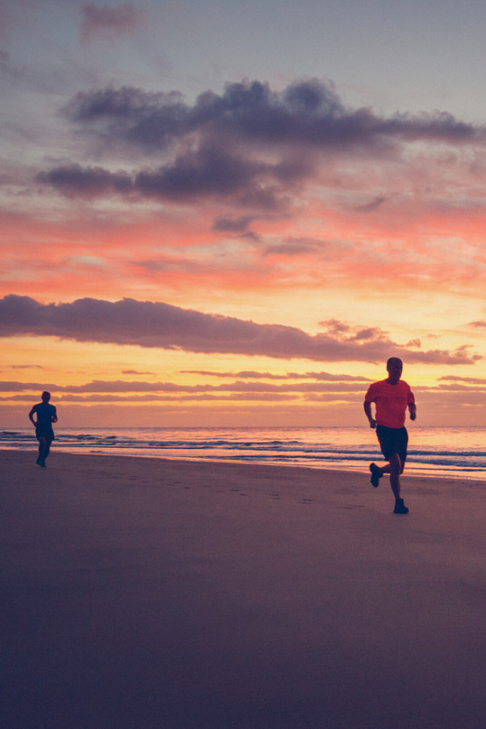 Running on the beach during the sunrise