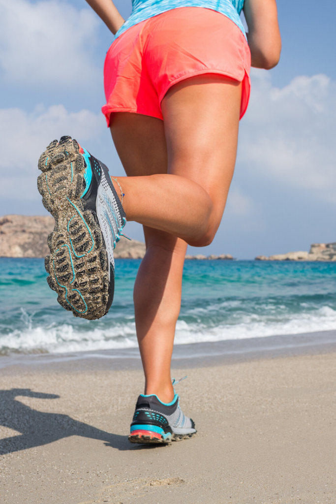 Women running on the beach