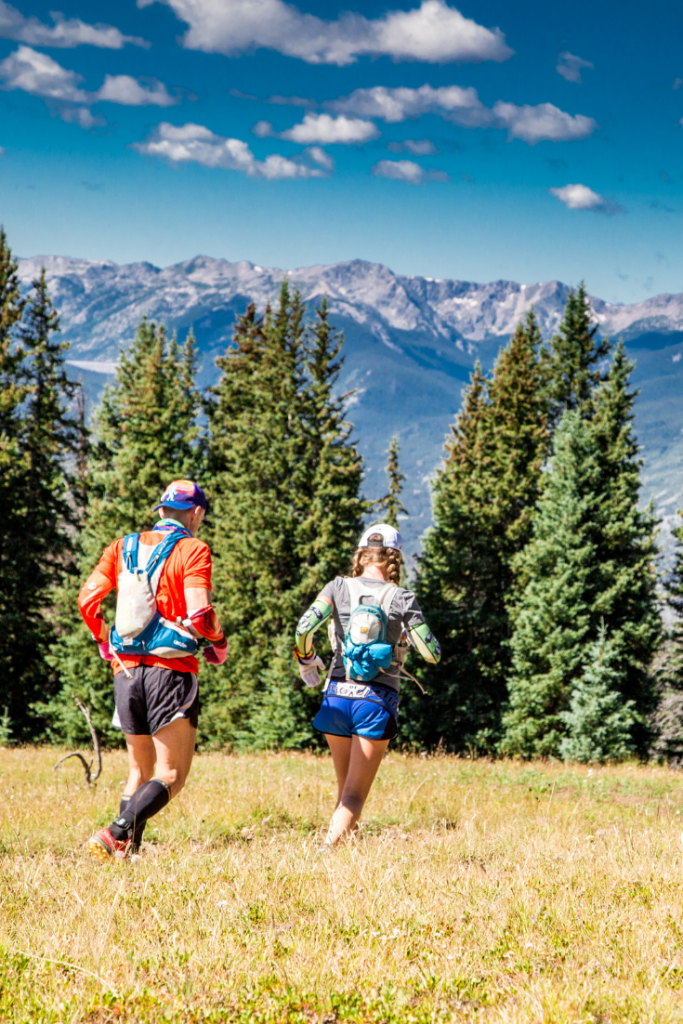 Geoff Hart and Heather Hart climbing hill during TransRockies Run 6 day stage race