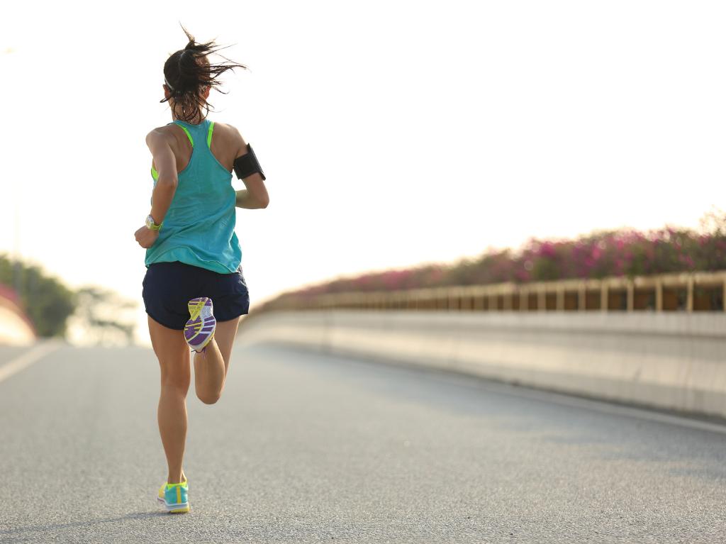 Female runner running down the street