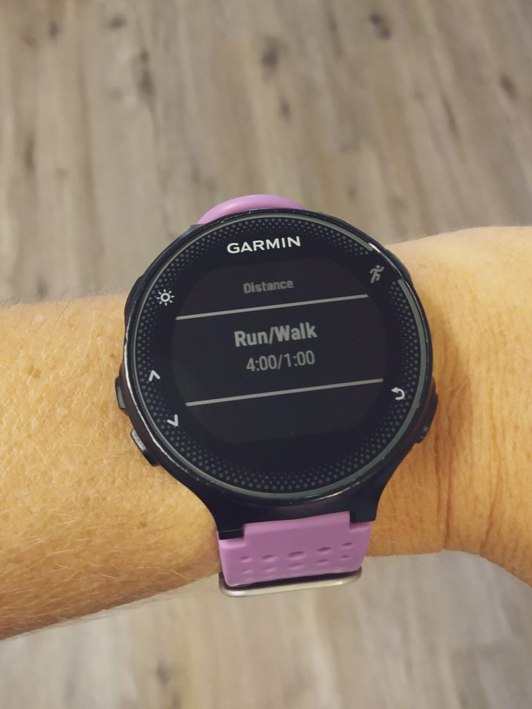 Garmin Forerunner watch displaying run/walk intervals.   Countless athletes utilize run/walk strategies for ultramarathon success.  Learn the science behind run/walking, and how to execute it on race day.