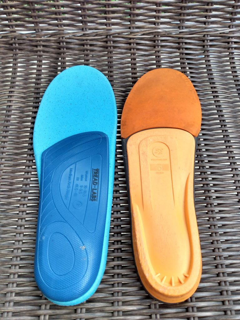 The bottom plastic molded arches of aftermarket insoles for running shoes