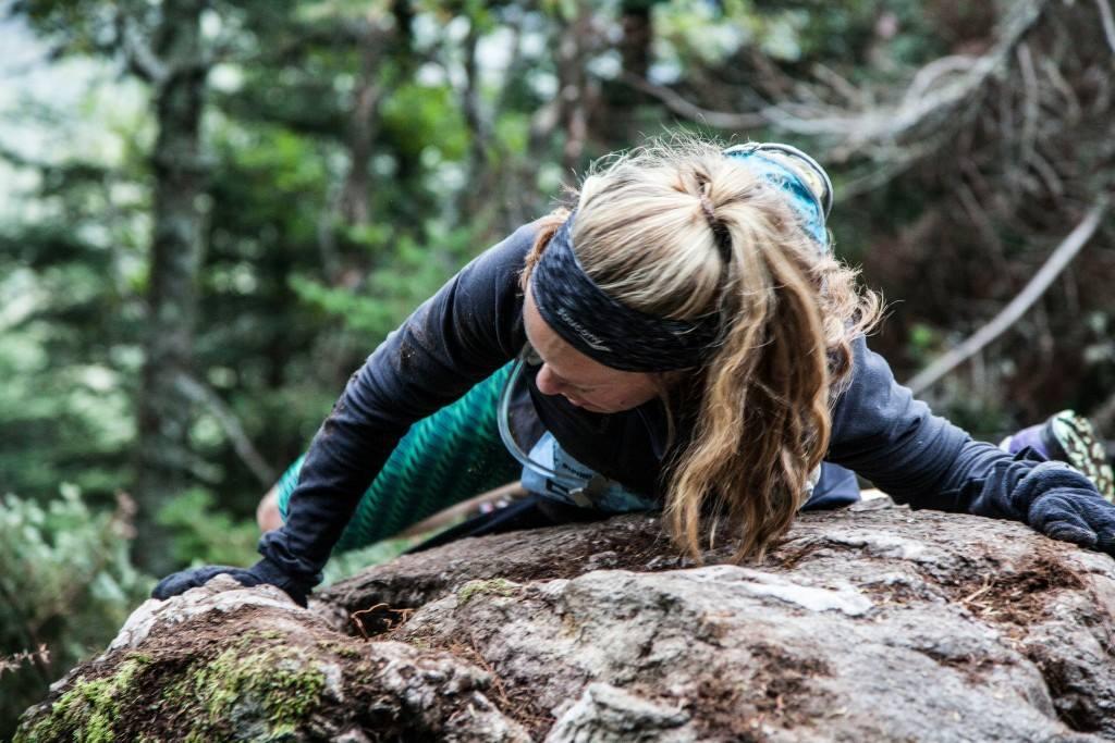 Heather Hart climbing a rock during o2X race