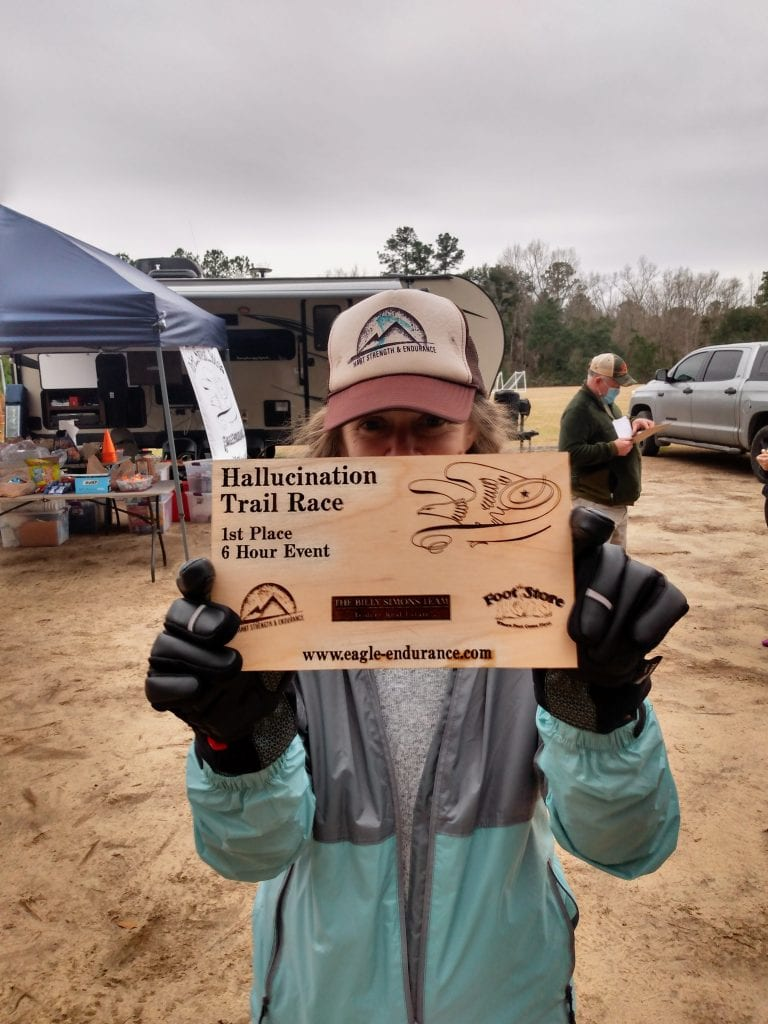 Heather Hart with first place trophy at the 2021 Hallucination 6 12 24 hour trail