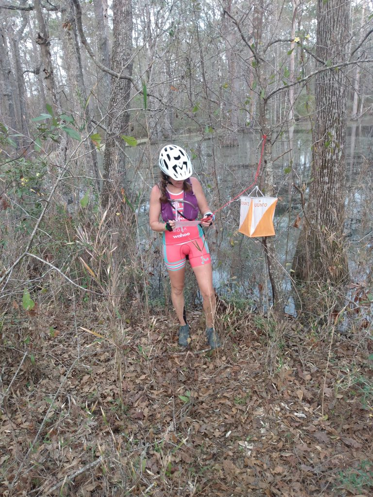 Heather Hart stamping a checkpoint at the 2021 Palmetto Swamp Fox Adventure Race