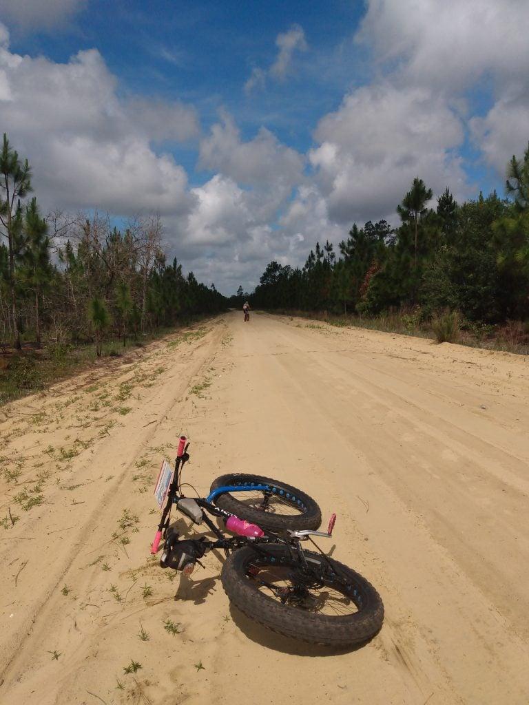 Mountain bike in a very sandy road