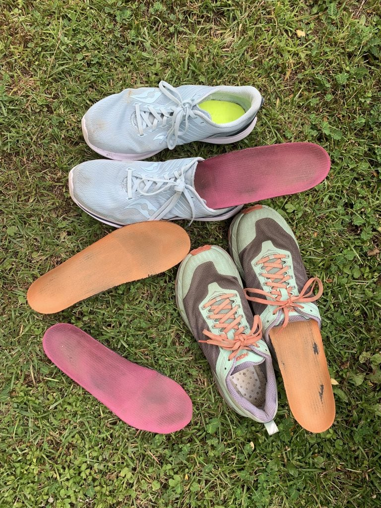 Ariel view of various types of Superfeet insoles in running sneakers