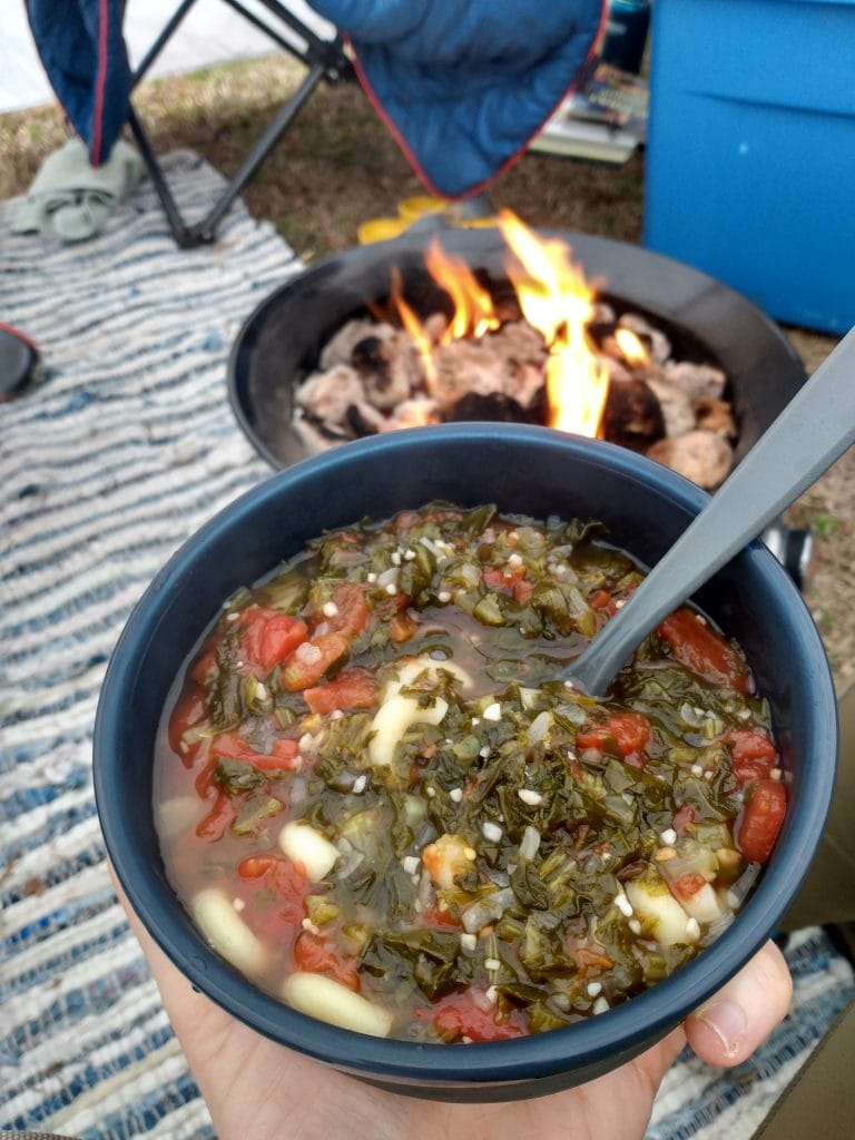 bowl of healthy soup in front of a campfire
